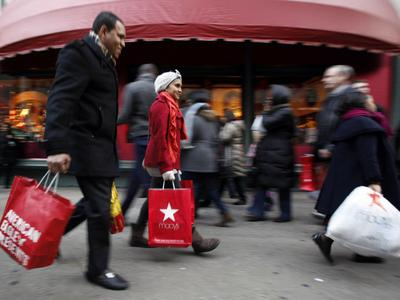 Americans boosted their spending at a 4.4 percent pace in the fourth quarter, the most since 2006. (AP)
