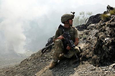 """Sergeant Brendan O'Byrne of Second Platoon, Battle Company awaits for a helicopter supply drop at Outpost Restrepo, in the Korengal Valley, Kunar Priovince, Afghanistan. (© Outpost Films/ 2010 Tim Hetherington, from """"Restrepo."""")"""