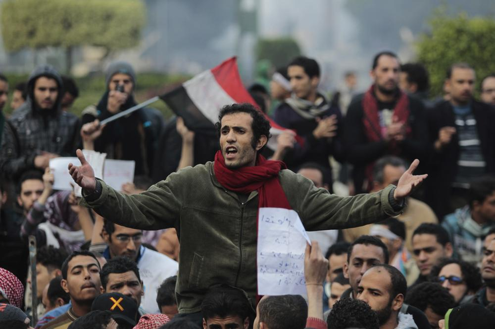 Egyptian anti-government protesters chant slogans as they gather in Tahrir square in Cairo, Egypt, Saturday, Jan. 29, 2011.  Mobile phone service have been partially restored in Egypt, Saturday, after the recent communications blackout. (AP Photo/Lefteris Pitarakis)