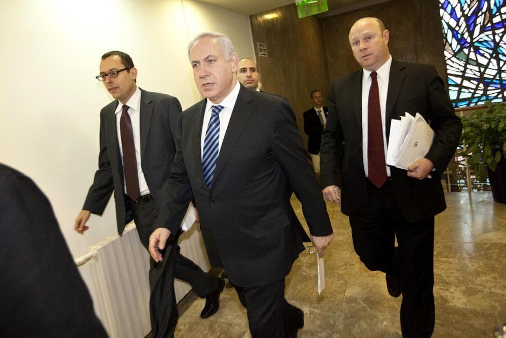 Israeli Prime Minister Benjamin Netanyahu, center, arrives at the weekly cabinet meeting in Jerusalem, Sunday, Jan. 30, 2011.  (AP Photo/Tomer Appelbaum, Pool)