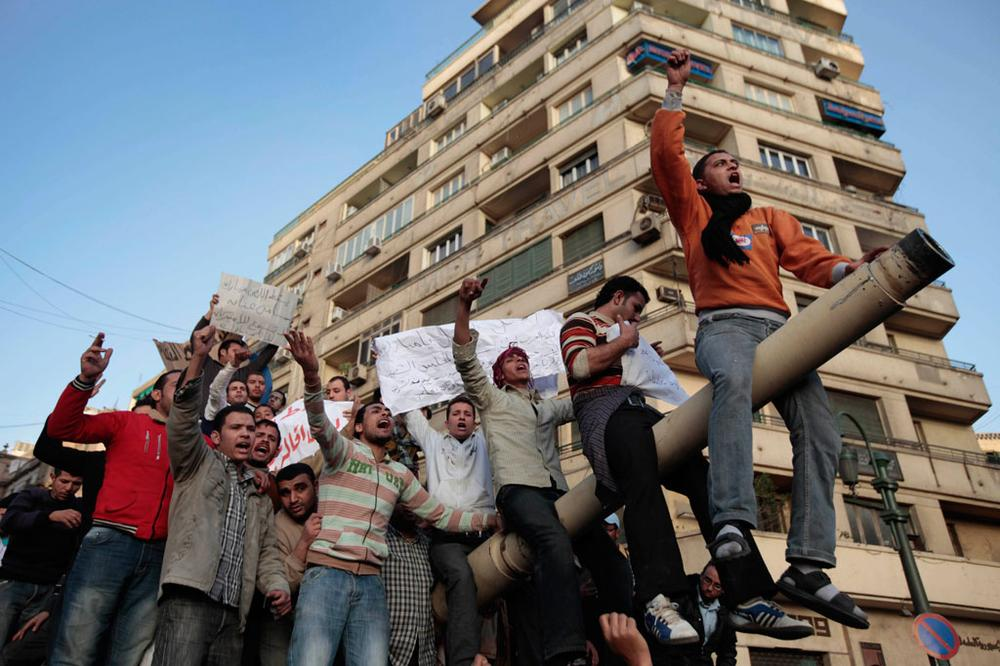 Egyptian anti-government protesters chant slogans as they stand atop an Egyptian army tank during a protest in Tahrir Square in Cairo, Egypt, Saturday. (Lefteris Pitarakis/AP)