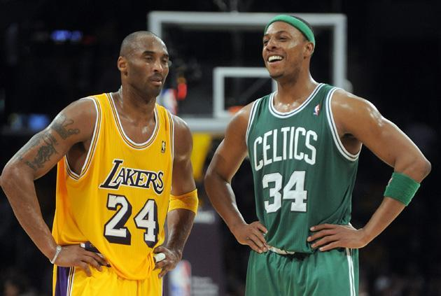 Los Angeles Lakers guard Kobe Bryant, left, listens to Boston Celtics forward Paul Pierce during the final seconds of an NBA basketball game in Los Angeles on Sunday. The Celtics won 109-96. (AP)