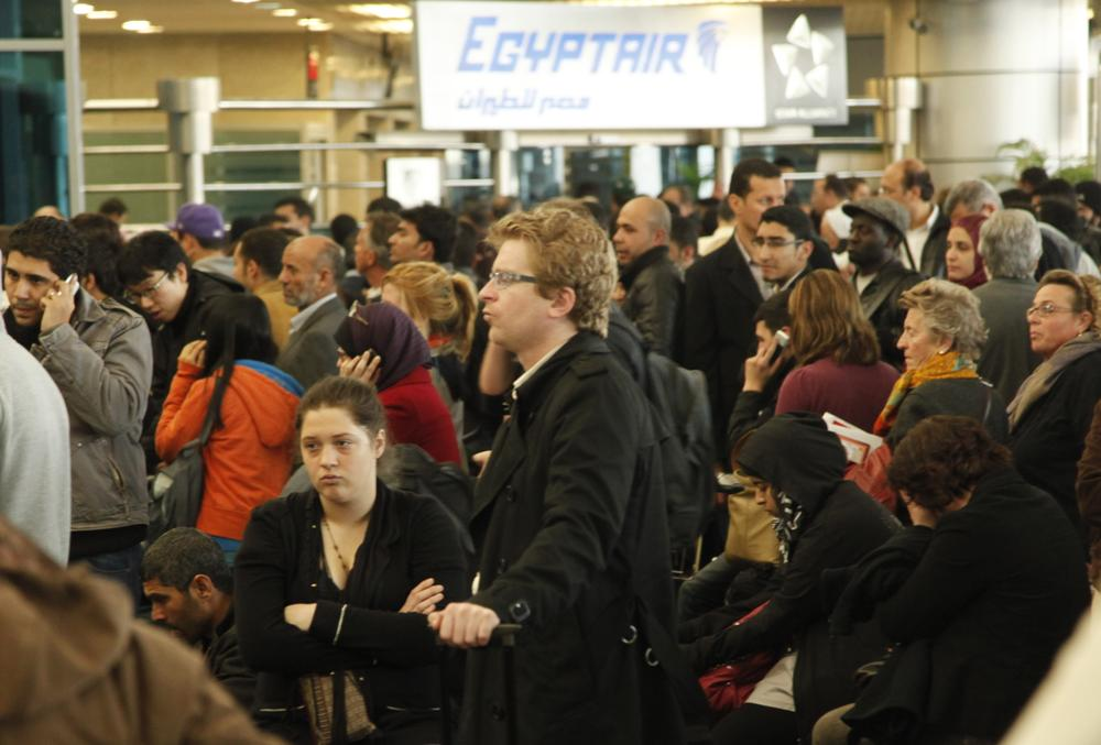 Passengers wait for check-in at Cairo's international airport, outside Cairo, Egypt. (AP)