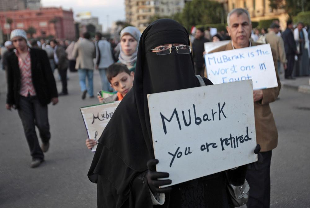 A woman carrying a placard referring to Egyptian President Hosni Mubarak attends a demonstration by anti-government protesters in Cairo's Tahrir Square. (AP)