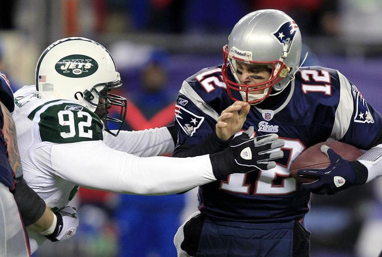 New York Jets Shaun Ellis sacks New England Patriots quarterback Tom Brady during the NFL divisional playoff football game. (AP)