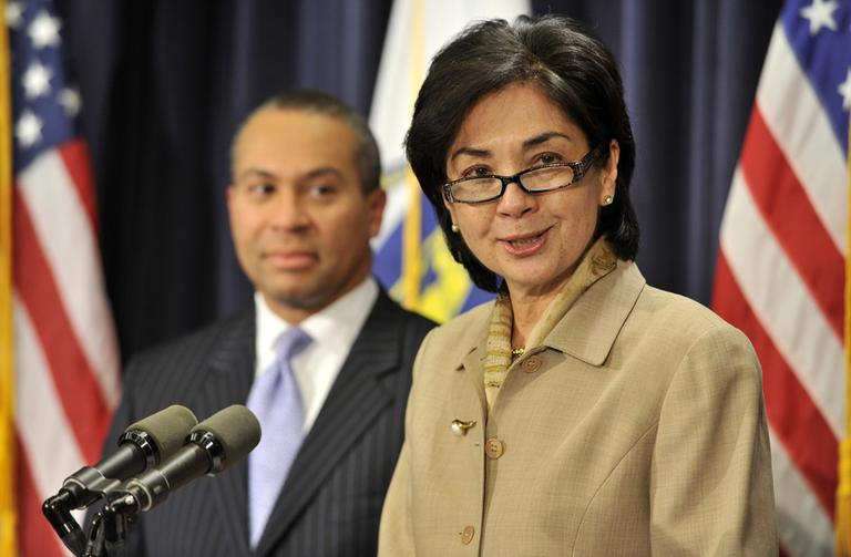 Gov. Deval Patrick looks on at Appeals Court Justice Fernande Duffly during a news conference at the State House Dec. 21, 2010. (AP)