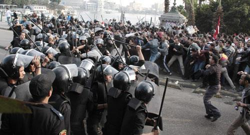 Police face demonstrators in Cairo, Jan. 25, 2011, during a Tunisia-inspired demonstration. (AP)
