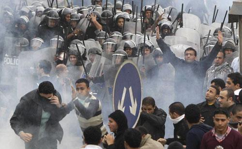 Egyptian anti-government activists clash with riot police in Cairo, Egypt, Friday, Jan. 28, 2011. (AP)