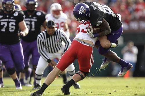 TCU wide receiver Jimmy Young (88) is stopped by Wisconsin linebacker Mike Taylor (53) during the first half of the Rose Bowl, Jan. 1, 2011, in Pasadena, Calif. (AP)