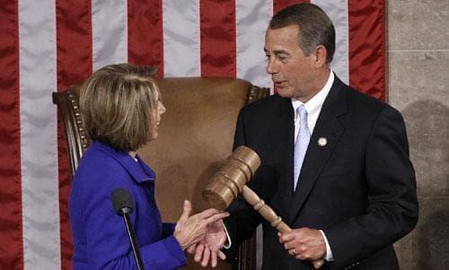 Outgoing Speaker Nancy Pelosi of California hands the gavel to Speaker-elect John Boehner of Ohio, Jan. 5, 2011. (AP)
