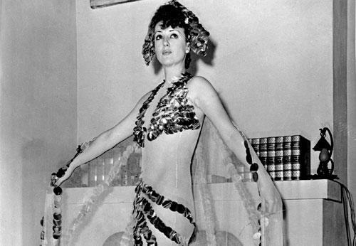 Gypsy Rose Lee, whose real name was Louise Hovick, shows off her costume, called 'Eclipse of the Sun.' (AP)