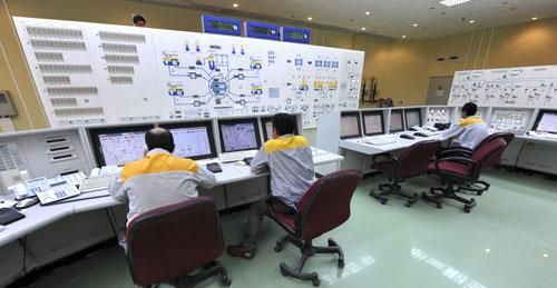 Iranian technicians work at the Bushehr nuclear power plant in Iran, Nov. 23, 2010 (AP)