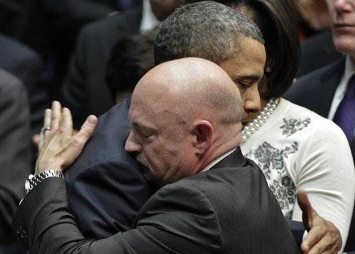 President Barack Obama embraces Mark Kelly, right, the husband of critically wounded Rep. Gabrielle Giffords, at the University of Arizona, Jan. 12, 2011. (AP)