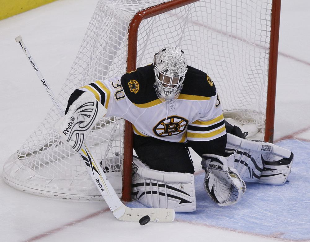 Boston Bruins' Tim Thomas has been a brick wall leading the league in save percentage with .945. (AP)