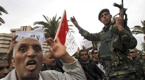 Protestors shout slogans, in Tunisia, Thursday, Jan. 20. 2011. (AP)
