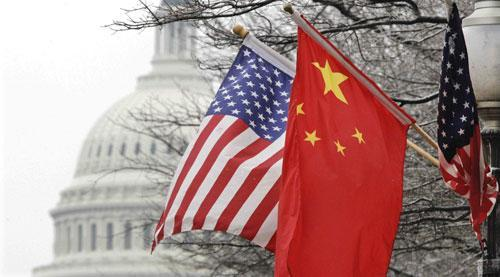 The Capitol dome is seen at rear as Chinese and U.S. flags are displayed in Washington, Jan. 18, 2011. (AP)
