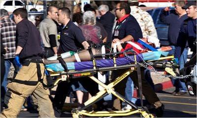 Emergency personnel carry Rep. Gabrielle Giffords in Tucson, Ariz. Jan. 8, 2011 (AP)