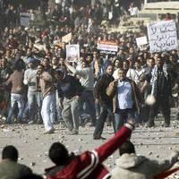 Pro-government supporters, top, clash anti-government protestors in Cairo's main square, Egypt, Wednesday, Feb.2, 2011. (AP)