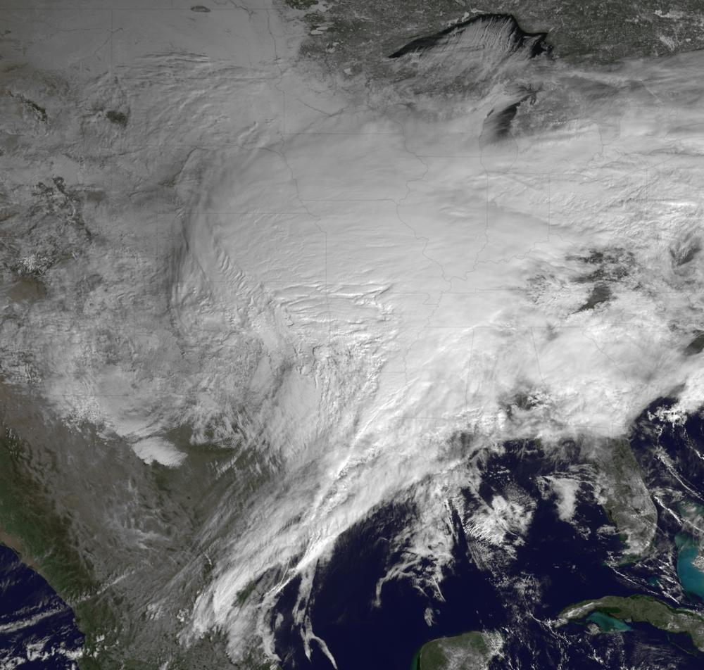 This satellite image shows a huge swath of the United States affected by a winter storm that's more than 2,000 miles in reach and has already caused roads and airports to close from Texas to Rhode Island. (AP/NOAA)