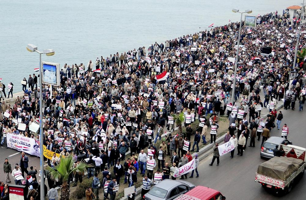 Egyptians shout anti-Mubarak slogans during a march on Alexandria's Mediterranean Sea bank, Egypt, Thursday. (AP)