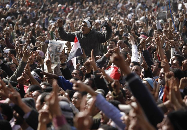 Anti-government protesters chant in Tahrir Square, Cairo, Friday. (AP)