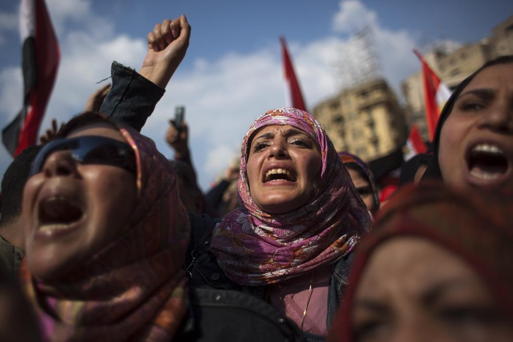 Egyptian anti-Mubarak protesters shout slogans during a demonstration at Tahrir Square in Cairo, Egypt, Tuesday, Feb. 8, 2011. (AP)