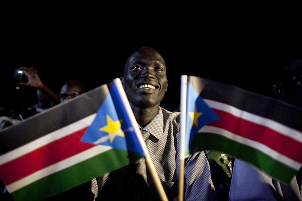 A southern Sudanese man watches a publicly televised broadcast of the formal announcement of referendum results in the southern capital of Juba. (AP)