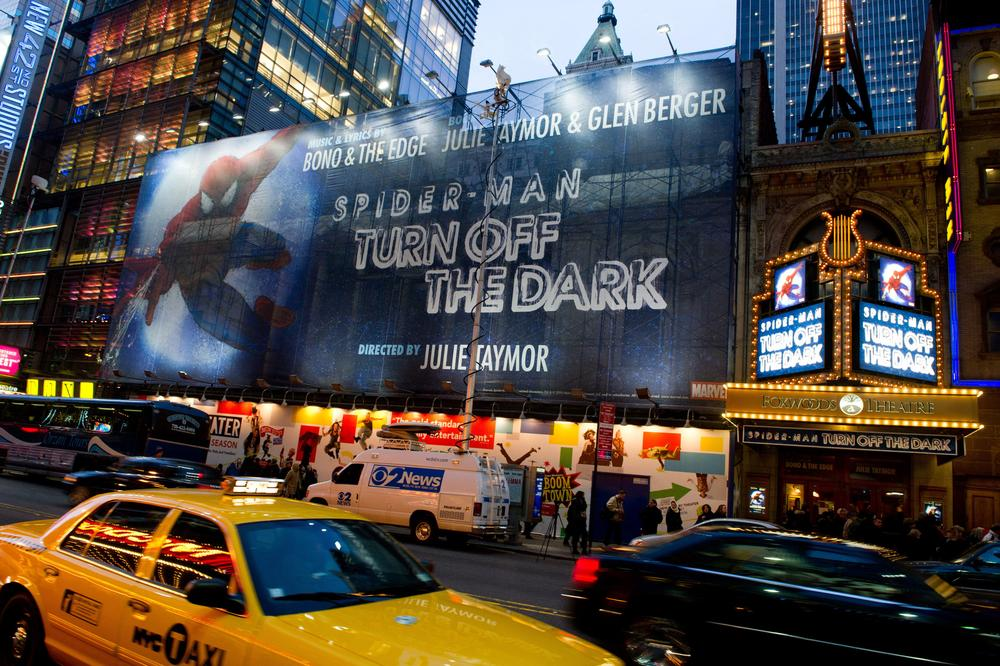 A billboard and the marquee for the Broadway musical 'Spider-Man Turn: Off the Dark' are seen outside the Foxwoods Theatre on West 42nd Street in New York. (AP)