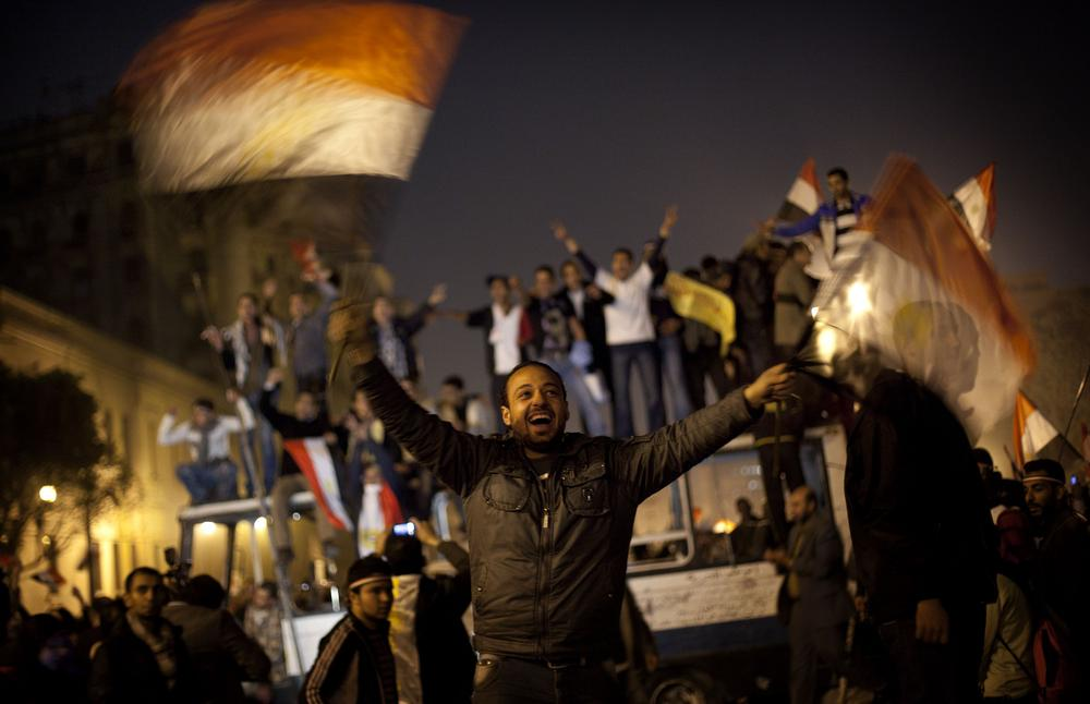 Anti-government protesters celebrate in Tahrir Square in downtown Cairo, Egypt. (AP)