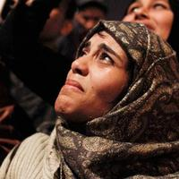 An Egyptian woman cries as she celebrates the news of the resignation of President Hosni Mubarak, who handed control of the country to the military, at night in Tahrir Square in downtown Cairo, Egypt  Friday, Feb. 11, 2011. (AP)