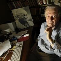 Political thinker Gene Sharp at his office in Boston with a photo of Gandhi at rear. (AP)