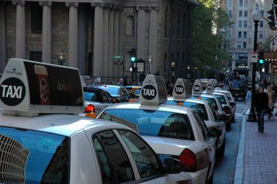 Cabs wait at a taxi stand near Tremont Street in Boston. (rkelland/Flickr)