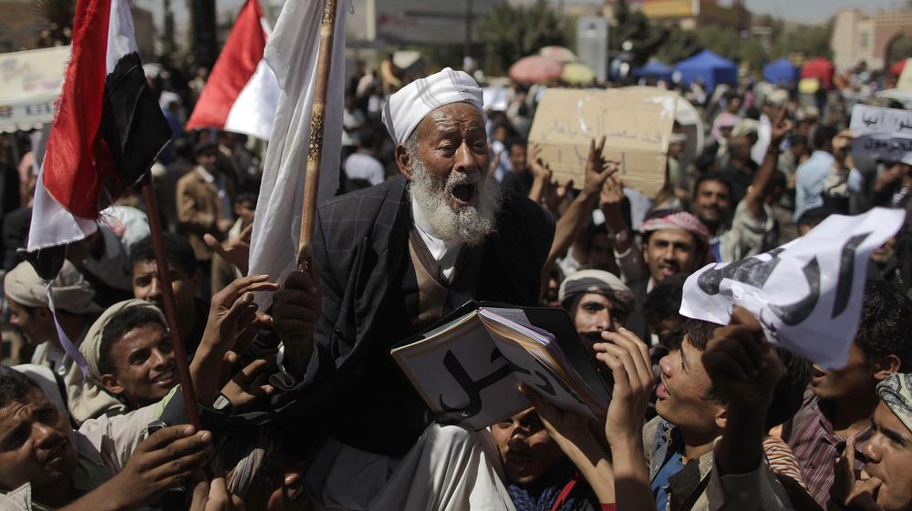 An elderly Yemeni anti-government demonstrator shouts slogans during a demonstration demanding the resignation of President Ali Abdullah Saleh, in Sanaa, Yemen. (AP)