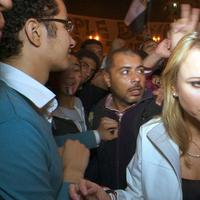 """In this Feb. 11, 2011 photo released by CBS, """"60 Minutes"""" correspondent Lara Logan is shown covering the reaction in in Cairo's Tahrir Square the day Egyptian President Hosni Mubarak stepped down.  (AP)"""