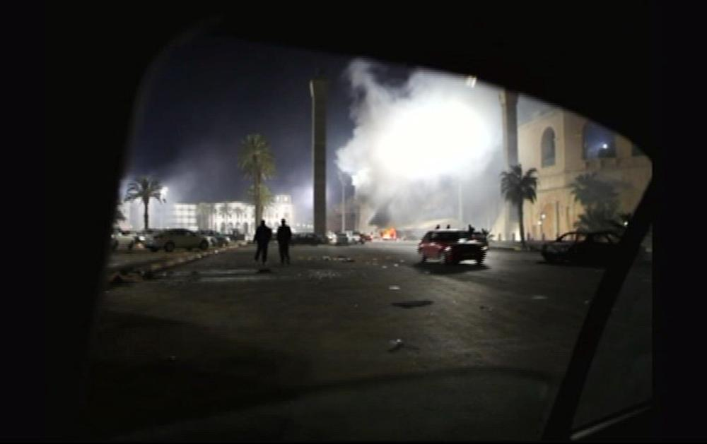A fire burns in a street in the Libyan capital Tripoli in the early hours Tuesday Feb. 22, 2011 in this image taken from TV. (AP/APTN)