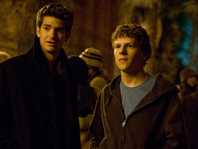 """Eduardo Saverin, played by Andrew Garfield, and Mark Zuckerberg, played by Jesse Eisenberg, are major characters in """"The Social Network."""" (Merrick Morton/Columbia Pictures)"""