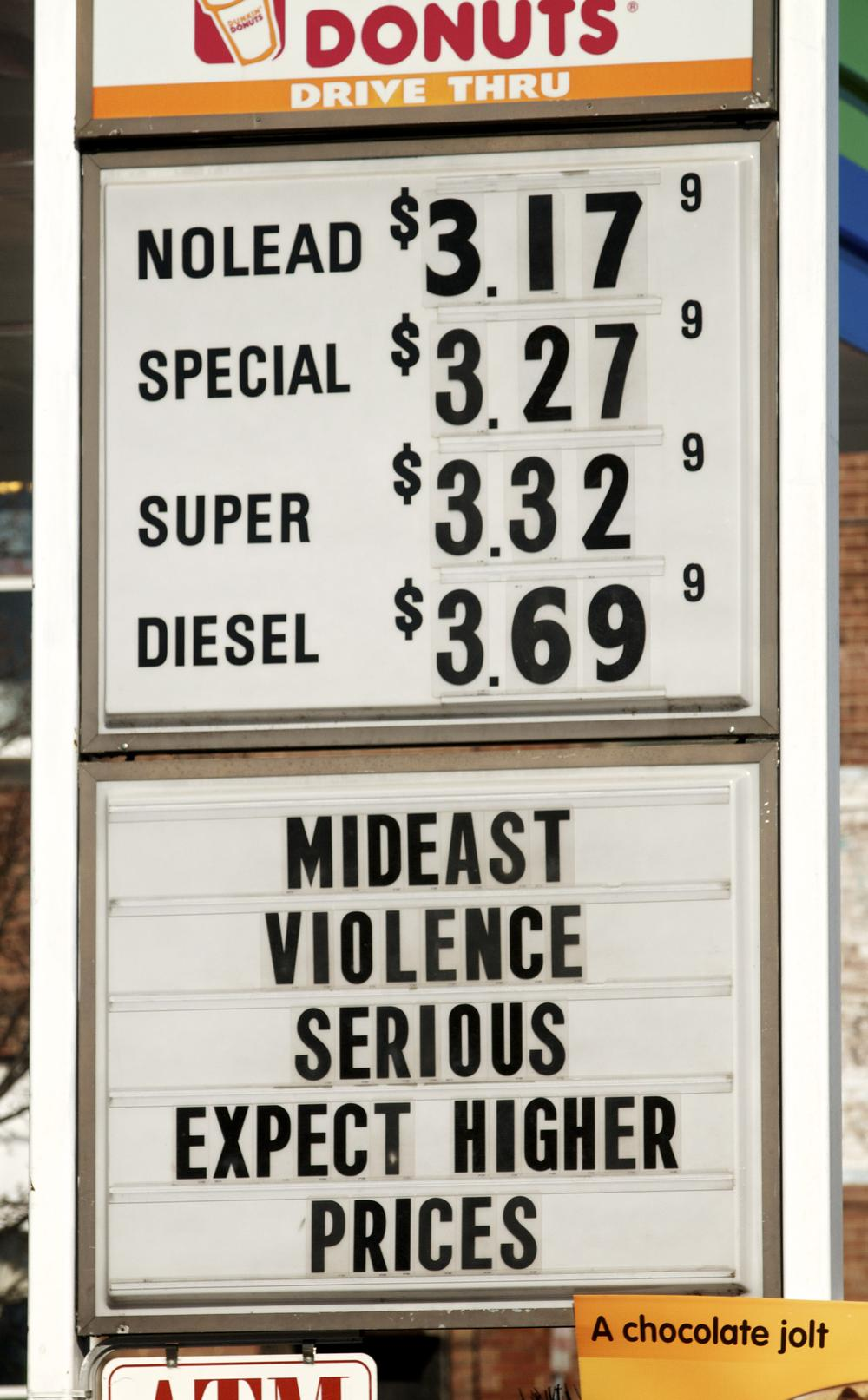 A sign advertises gas and diesel prices at a service station in Easthampton, Mass, Wednesday, Feb. 23, 2011. (AP)