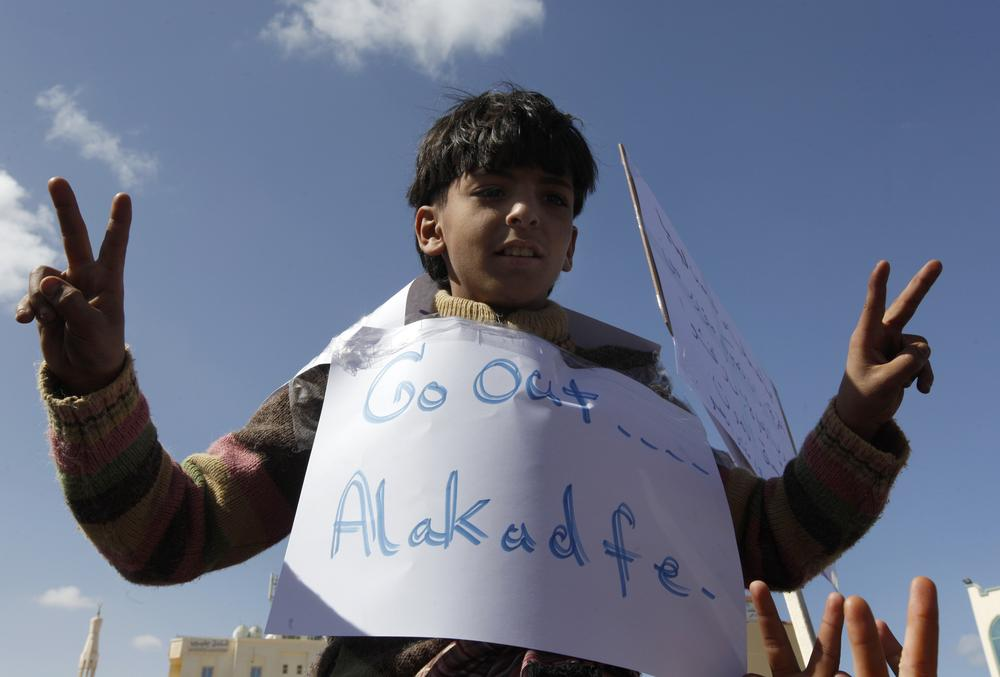 A Libyan boy flashes a V sign as he protests against Libyan Leader Moammar Gadhafi, in Tobruk, Libya, on Wednesday Feb. 23, 2011. (AP)