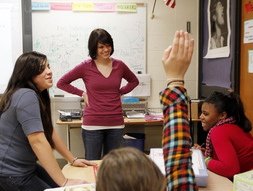 Erin Gavin, a Teach for America teacher, listens to seventh-graders at a Brooklyn Center School in Brooklyn Center, Minn.   (AP)