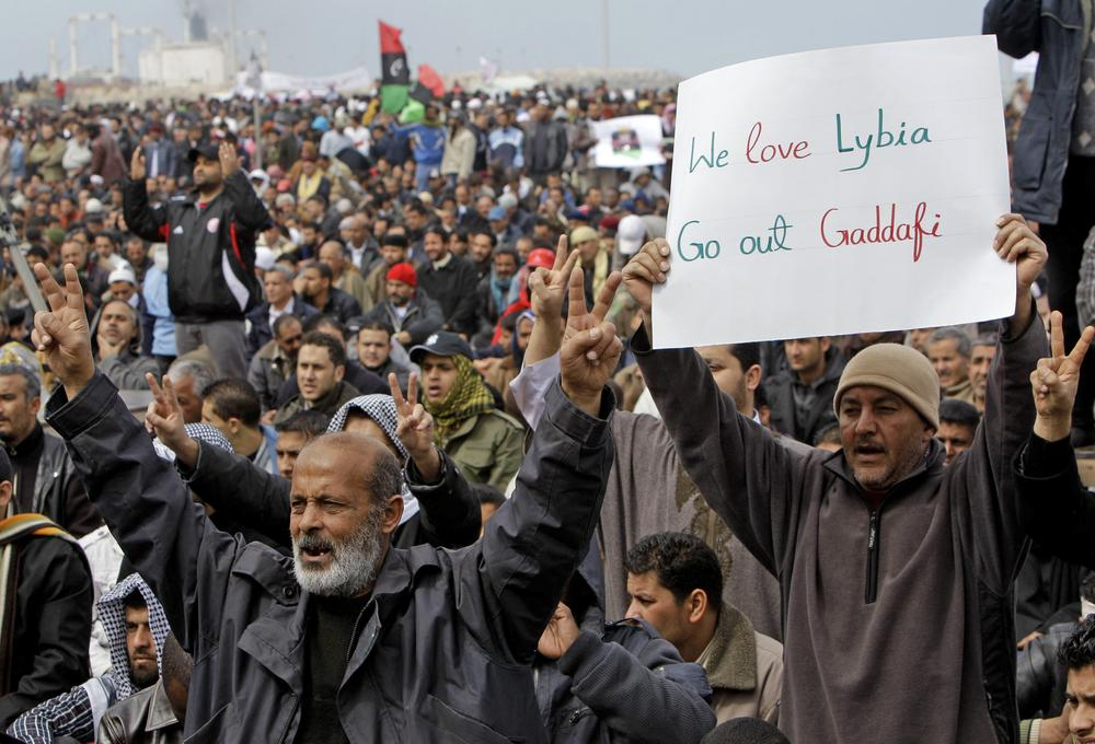 Libyan protesters shout slogans against Libyan Leader Moammar Gadhafi during a demonstration at the court square, in Benghazi, Libya. (AP)