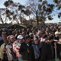 Egyptians who worked Libya and fled the unrest in the country wait to register as they arrive at a refugee camp set up by the Tunisian army, at  the Tunisia-Libyan border, in Ras Ajdir, Tunisia. (AP)