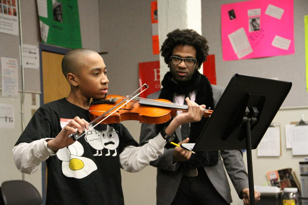 Roy'al Sanyika-Hall, 13, auditions at the Boston Arts Academy with strings instructor Bryan Brash.  (Kirk Carapezza for WBUR)