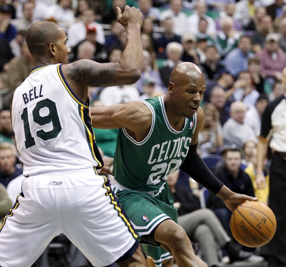 Boston Celtics guard Ray Allen (20) drives around Utah Jazz guard Raja Bell (19) during the first half of the game in Salt Lake City on Monday. (AP)