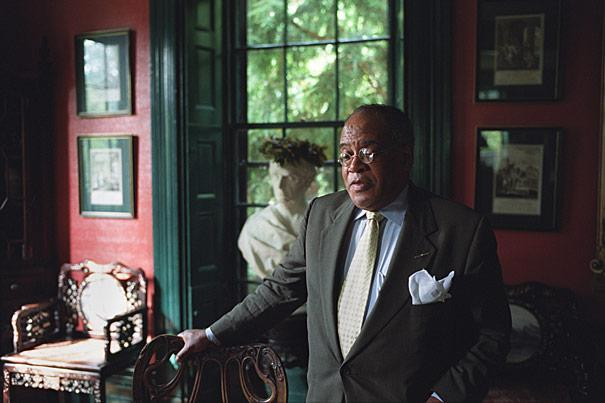 Rev. Peter Gomes spends a moment inside Sparks House at Harvard University, in 2002. (Courtesy Kris Snibbe/Harvard University News Office)