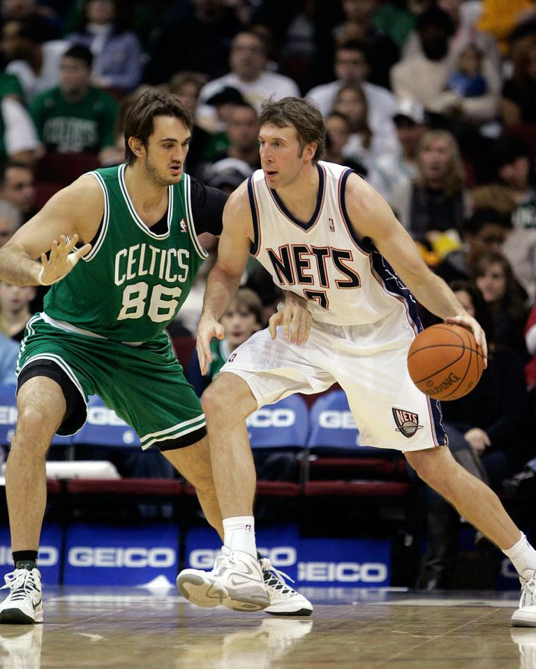 In this Dec. 5, 2010 photo, Nets' Troy Murphy (7) moves with the ball as former Celtic Semih Erden defends. (AP)