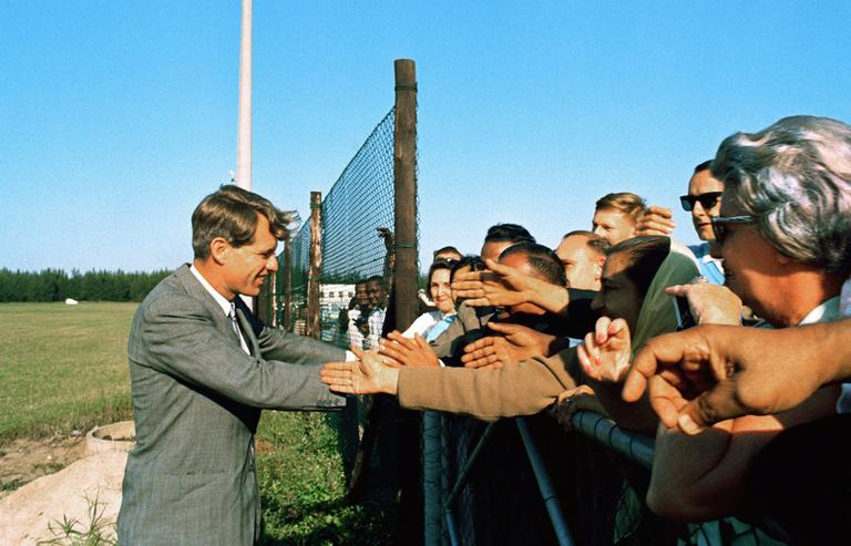 Sen. Robert F. Kennedy visiting Peace Corps members in Tanzania 1966. (AP)