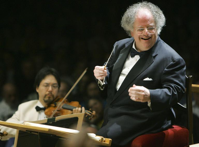 This photo taken July 7, 2006 shows Boston Symphony Orchestra music director James Levine, right, conducting the symphony on its opening night performance at Tanglewood in Lenox., Mass. (AP)