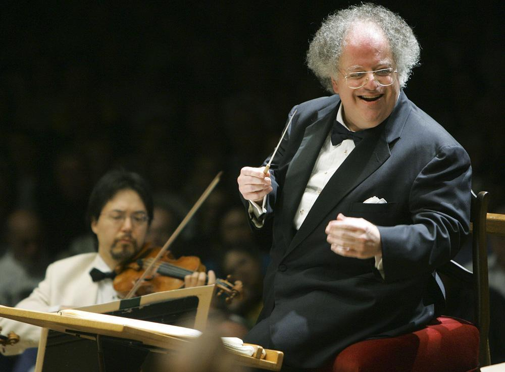 This photo taken July 7, 2006 shows former Boston Symphony Orchestra music director James Levine, right, conducting the symphony on its opening night performance at Tanglewood in Lenox., Mass. (AP)
