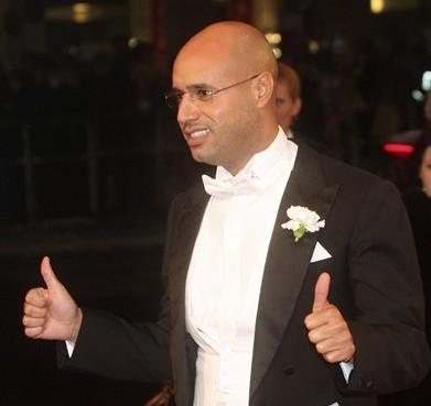Saif al Gadhafi, son of Libyan leader Moammar Gadhafi, gives his thumbs up when arriving for the traditional opera ball in front of the state opera in Vienna, on Thursday, Feb. 11, 2010. (AP)