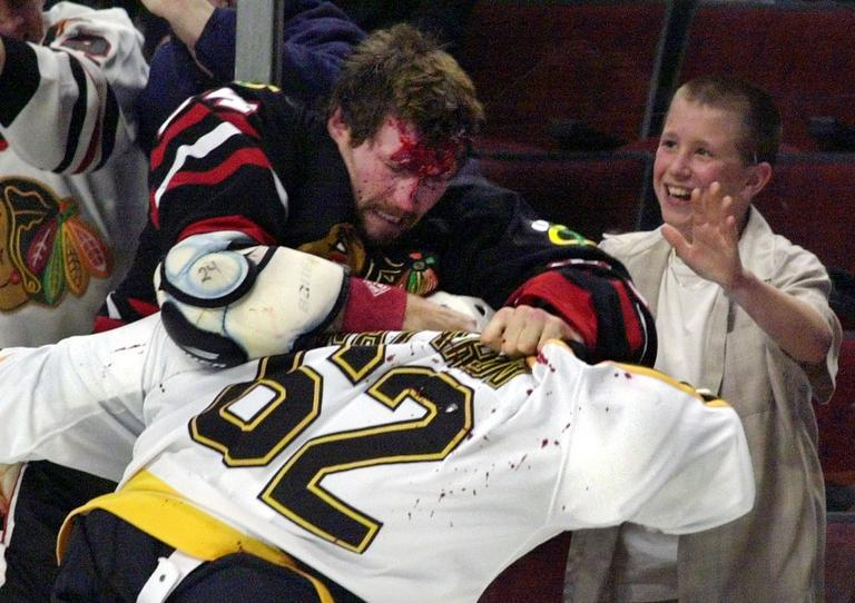 Chicago Blackhawks Bob Probert and Boston Bruins Andrei Nazarov (62) fight along the boards during a game on Oct. 28, 2001 in Chicago. Probert died of a heart attack at the age of 45. (AP)